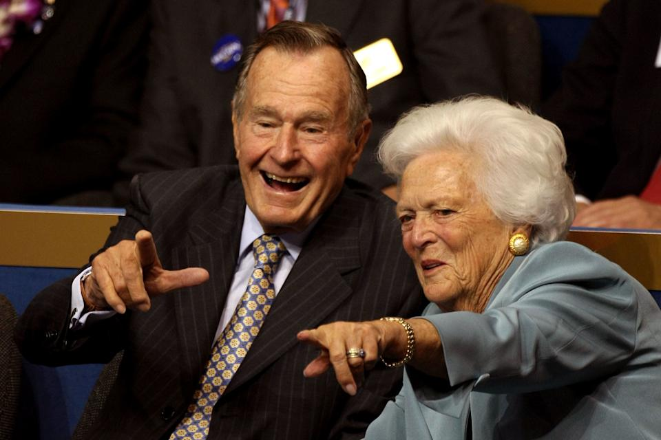 George H.W. and Barbara Bush point from their seats on day two of the Republican National Convention at the Xcel Energy Center on Sept. 2, 2008, in St. Paul, Minnesota.