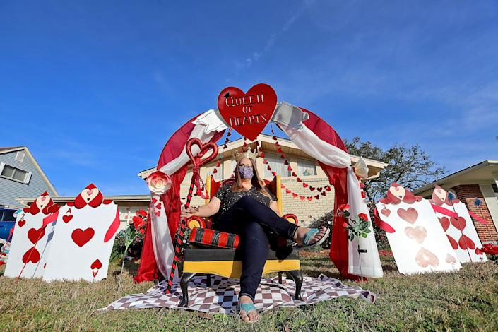 Meghan Davis sits in her Alice in Wonderland display in the front yard of her Algiers home in New Olreans.