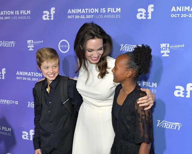 <p>Here are Angelina, Shiloh, and Zahara at the premiere of The Breadwinner in Hollywood on Oct. 20. She was executive producer of the film, which is about a headstrong girl in Afghanistan who disguises herself as a boy in order to provide for her family. (Photo: Neilson Barnard/Getty Images) </p>