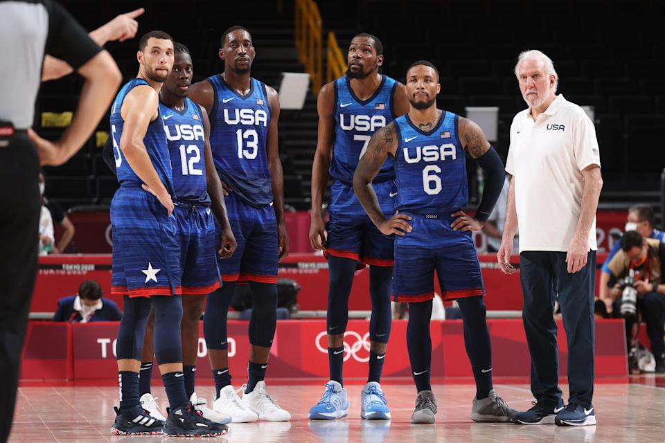 Head Coach Gregg Popovich, right, and members of the U.S. men's basketball team look on in disbelief during their loss to France in the opening game of the Tokyo Olympics.
