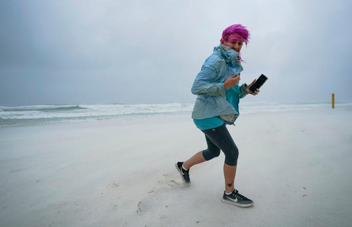 Courtney Watts, of Tuscaloosa, Ala., moves off the beach at Gulf State Park on Sept. 15, 2020, in Gulf Shores, Ala.