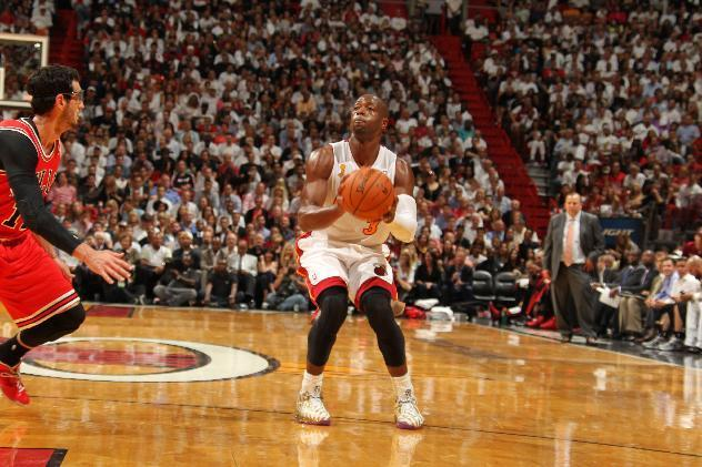 MIAMI, FL - OCTOBER 29: Dwyane Wade #3 of the Miami Heat sets up for a shot against the Chicago Bulls on October 29, 2013 at AmericanAirlines Arena in Miami, Florida. (Photo by Issac Baldizon/NBAE via Getty Images)