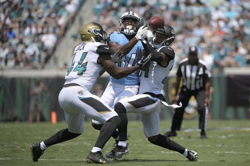 Jacksonville Jaguars outside linebacker Myles Jack (44) and cornerback A.J. Bouye (21) break up a pass. (AP)