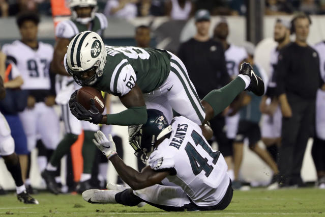 New York Jets' Clive Walford (87) is tackled by Philadelphia Eagles' Jeremy Reaves (41) during the second half of a preseason NFL football game Thursday, Aug. 30, 2018, in Philadelphia. (AP Photo/Matt Rourke)