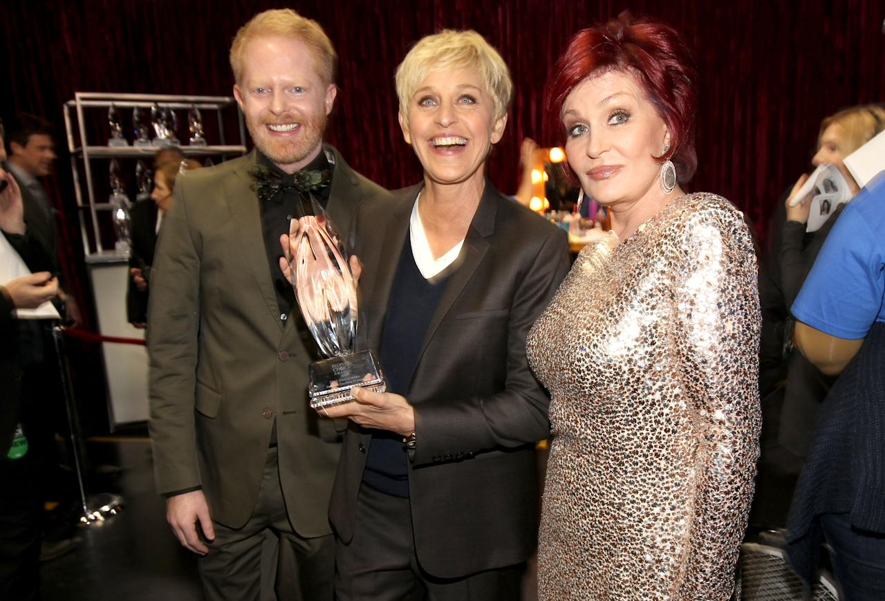 """LOS ANGELES, CA - JANUARY 11:  (L-R) Actor Jesse Tyler Ferguson, Ellen DeGeneres and Sharon Osbourne pose with the """"Favorite Daytime TV Host"""" award backstage during the 2012 People's Choice Awards at Nokia Theatre L.A. Live on January 11, 2012 in Los Angeles, California.  (Photo by Christopher Polk/Getty Images for PCA)"""