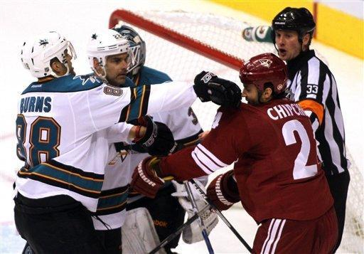 Phoenix Coyotes' Kyle Chipchura, right, fights with San Jose Sharks Brent Burns (88) during the third period of their NHL hockey game Saturday, Feb, 4, 2012 in Glendale, Ariz. (AP Photo/Darryl Webb)