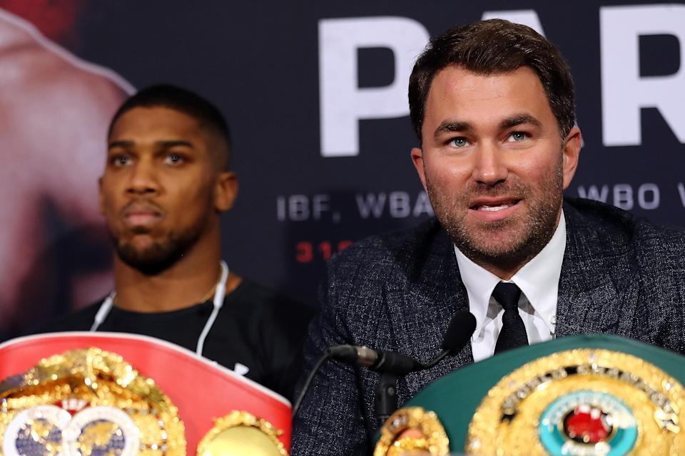 Promoter Eddie Hearn (R) said he is closing in on a deal for IBF-WBA-WBO heavyweight champion Anthony Joshua (L) to defend his title in September against Alexander Povetkin. (Getty Images)