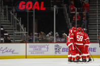 Detroit Red Wings' Dennis Cholowski (21) celebrates his goal against the Arizona Coyotes in the first period of an NHL hockey game Tuesday, Nov. 13, 2018, in Detroit. (AP Photo/Paul Sancya)