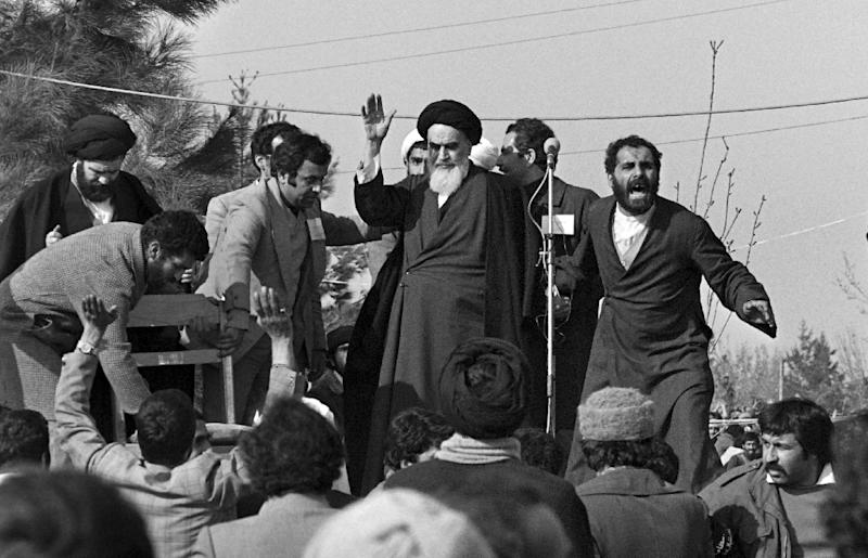 Ayatollah Khomeini greets supporters after his return to Iran in February 1979 (AFP Photo/GABRIEL DUVAL)