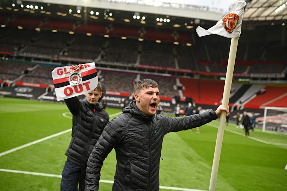 United supporters on the Old Trafford pitchAFP via Getty Images