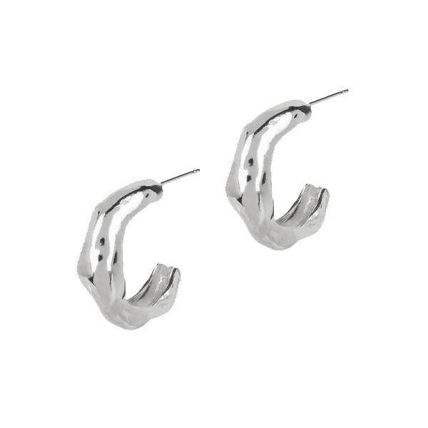 """<p><a class=""""link rapid-noclick-resp"""" href=""""https://go.skimresources.com?id=127X678080&xs=1&url=https%3A%2F%2Fmatthewcalvin.com%2Fcollections%2Fsilver-earrings%2Fproducts%2Frocha-hoops-silver"""" rel=""""nofollow noopener"""" target=""""_blank"""" data-ylk=""""slk:SHOP"""">SHOP</a></p><p>A little twist on the standard hoop earring, this pair is hand-carved from solid sterling silver with a high-polish shine creating the ultimate minimal, yet eye-catching look. Also available in <a href=""""https://matthewcalvin.com/products/rocha-hoops-gold"""" rel=""""nofollow noopener"""" target=""""_blank"""" data-ylk=""""slk:gold"""" class=""""link rapid-noclick-resp"""">gold</a>. <br></p><p>£98, Matthew Calvin</p>"""