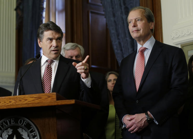 In this May 28, 2013 file photo, Lt. Gov. David Dewhurst , right, stands with Gov. Rick Perry during the signing of a water fund bill, in Austin, Texas. Now that the governor has called a special session, Dewhurst will get a chance to resurrect the anti-abortion legislation bill that failed earlier this week, but maybe not his political career. (AP Photo/Eric Gay)