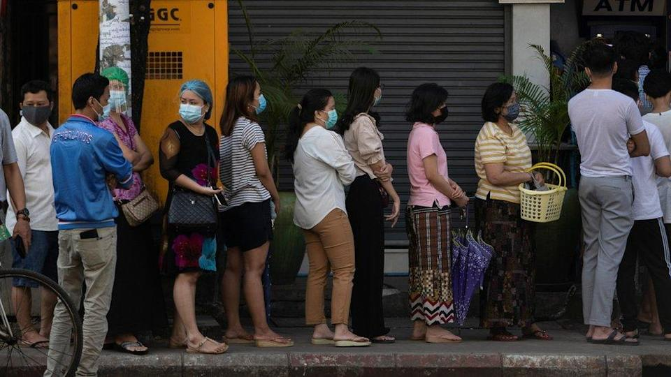 People line up outside a bank branch in Yangon, Myanmar, 1 February 2021.