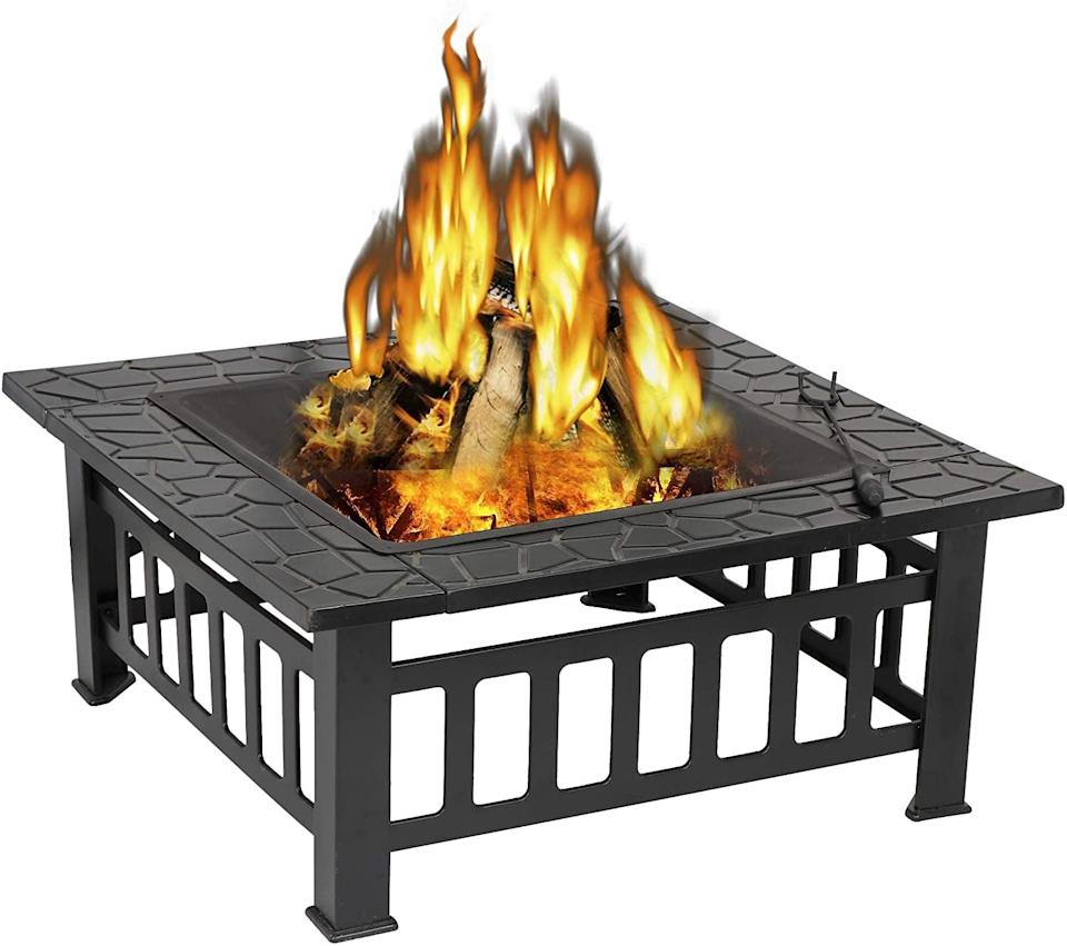 <p>Made from sleek black steel, the <span>Metal Fire Pit</span> ($102) will fit in with any existing backyard furniture.</p>
