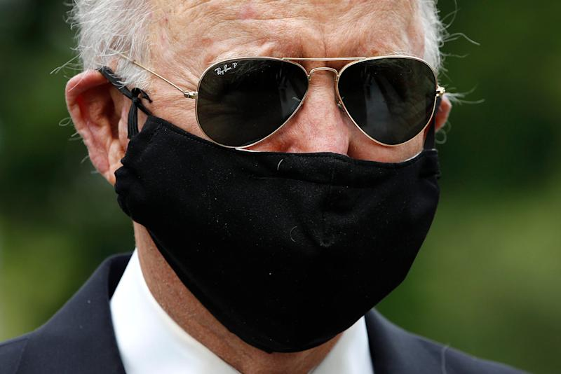 Democratic presidential candidate Joe Biden wears a face mask as he and his wife, Jill, depart after placing a wreath at the Delaware Memorial Bridge Veterans Memorial Park on May 25 in New Castle.