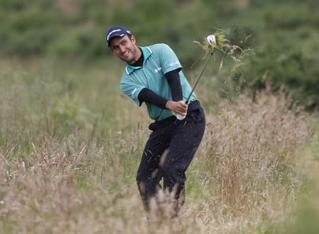 Italy's Edoardo Molinari plays out of the rough at the second hole during the final round of the Scottish Open golf tournament at Castle Stuart golf course near Inverness