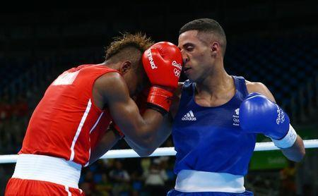 2016 Rio Olympics - Boxing - Preliminary - Men's Light Fly (49kg) Round of 32 Bout 39 - Riocentro - Pavilion 6 - Rio de Janeiro, Brazil - 08/08/2016. Joahnys Argilagos Perez (CUB) of Cuba and Galal Yafai (GBR) of United Kingdom compete. REUTERS/Peter Cziborra