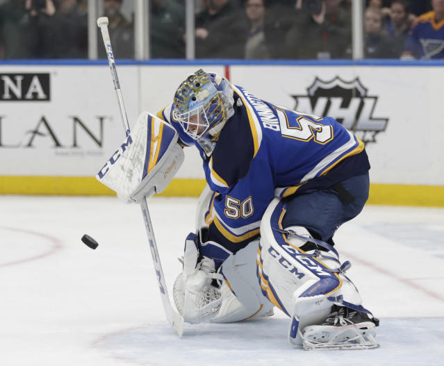 St. Louis Blues goaltender Jordan Binnington makes a stick save during the first period of the team's NHL hockey game against the Toronto Maple Leafs, Tuesday, Feb. 19, 2019, in St. Louis. (AP Photo/Tom Gannam)