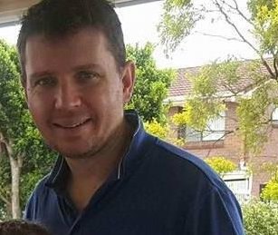 Passenger Christopher Woodgate, 38, was pronounced dead after the Brisbane-bound flight was diverted to Honolulu on Saturday. Source: Facebook