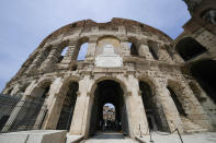 """A view of the ancient Colosseum, in Rome, Friday, June 25, 2021. After 2-and-1/2 years of work to shore up the Colosseum's underground passages, tourists will be able to go down and wander through part of what what had been the ancient arena's """"backstage."""" (AP Photo/Andrew Medichini)"""