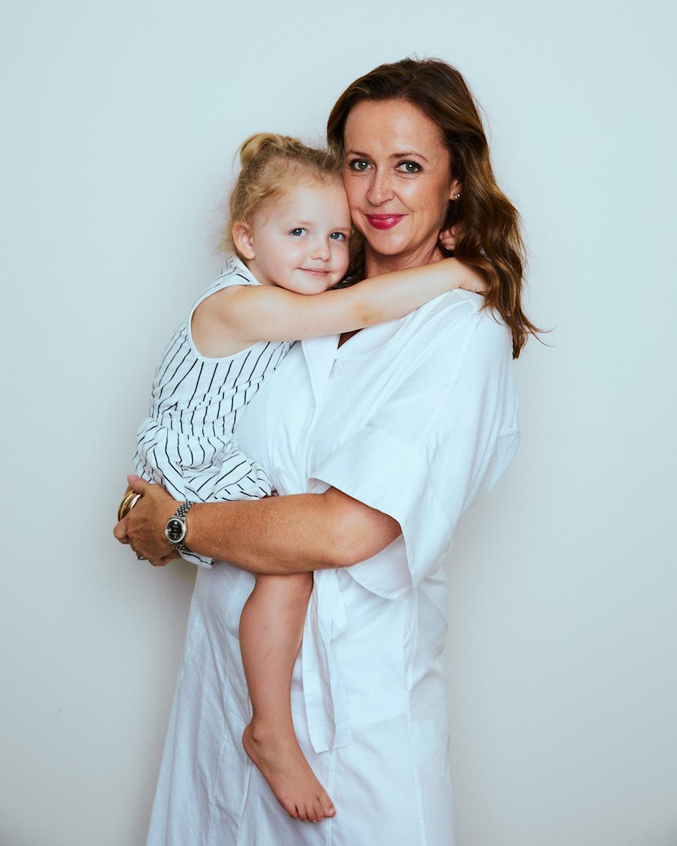 Alison Goodger and her daughter in white dresses