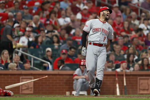 Cincinnati Reds' Eugenio Suarez drops his bat after being hit by a pitch during the fifth inning in the second baseball game of a doubleheader against the St. Louis Cardinals Sunday, Sept. 1, 2019, in St. Louis. Suarez left the game. (AP Photo/Jeff Roberson)