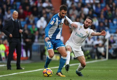 Soccer Football - La Liga Santander - Real Madrid vs Deportivo La Coruna - Santiago Bernabeu, Madrid, Spain - January 21, 2018 Deportivo de La Coruna's Adrian in action with Real Madrid's Dani Carvajal REUTERS/Sergio Perez
