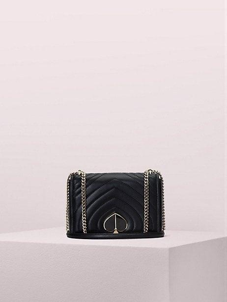 """<p>This classic <a href=""""https://www.popsugar.com/buy/Kate-Spade-New-York-Amelia-Convertible-Chain-Shoulder-Bag-486738?p_name=Kate%20Spade%20New%20York%20Amelia%20Convertible%20Chain%20Shoulder%20Bag&retailer=katespade.com&pid=486738&price=195&evar1=fab%3Aus&evar9=46206453&evar98=https%3A%2F%2Fwww.popsugar.com%2Fphoto-gallery%2F46206453%2Fimage%2F46571596%2FKate-Spade-New-York-Amelia-Convertible-Chain-Shoulder-Bag&list1=shopping%2Cfall%20fashion%2Cbags%2Csale%20shopping%2Ckate%20spade%20new%20york&prop13=api&pdata=1"""" rel=""""nofollow"""" data-shoppable-link=""""1"""" target=""""_blank"""" class=""""ga-track"""" data-ga-category=""""Related"""" data-ga-label=""""https://www.katespade.com/products/amelia-medium-convertible-chain-shoulder-bag/PXRUA179.html"""" data-ga-action=""""In-Line Links"""">Kate Spade New York Amelia Convertible Chain Shoulder Bag</a> ($195, originally $398) is a great purchase.</p>"""