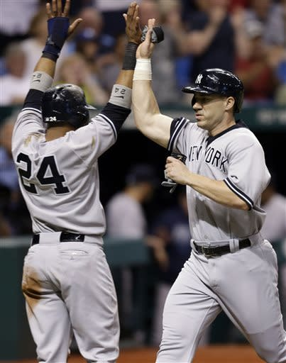 New York Yankees' Robinson Cano (24) and Travis Hafner celebrate after scoring on a ninth-inning, two run single by teammate Ichiro Suzuki off Tampa Bay Rays relief pitcher Fernando Rodney during a baseball game Tuesday, April 23, 2013, in St. Petersburg, Fla. (AP Photo/Chris O'Meara)