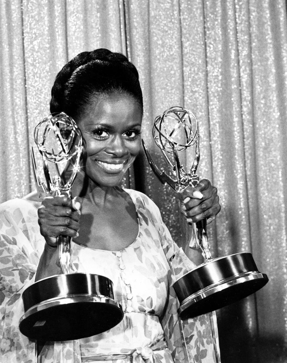 "FILE - Cicely Tyson poses with her Emmy statuettes at the annual Emmy Awards presentation in Los Angeles, Ca., May 28, 1974. Tyson won for her role in ""The Autobiography of Miss Jane Pittman"" for actress of the year, special, and best lead actress in a television drama for a special program. Tyson, the pioneering Black actress who gained an Oscar nomination for her role as the sharecropper's wife in ""Sounder,"" a Tony Award in 2013 at age 88 and touched TV viewers' hearts in ""The Autobiography of Miss Jane Pittman,"" has died. She was 96. Tyson's death was announced by her family, via her manager Larry Thompson, who did not immediately provide additional details. (AP Photo, File)"