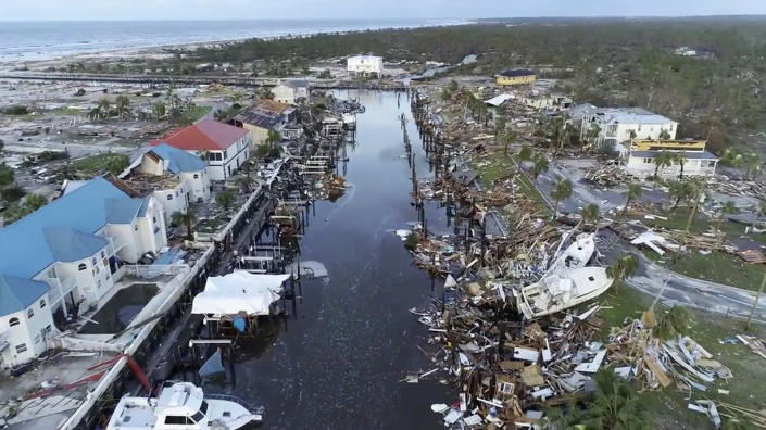 <p>In this image made from video and provided by SevereStudios.com, damage from Hurricane Michael is seen in Mexico Beach, Fla. on Thursday, Oct. 11, 2018. Search-and-rescue teams fanned out across the Florida Panhandle to reach trapped people in Michael's wake Thursday as daylight yielded scenes of rows upon rows of houses smashed to pieces by the third-most powerful hurricane on record to hit the continental U.S. (Photo: SevereStudios.com via AP) </p>