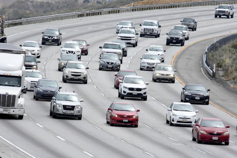 Traffic is seen on the Interstate 15 in the Cajon Pass, on Wednesday, May 15, 2019, near Hesperia, Calif. The Auto Club is reporting the the upcoming Memorial Day weekend may break another record for southern California travelers on the Interstates. (James Quigg/The Daily Press via AP)