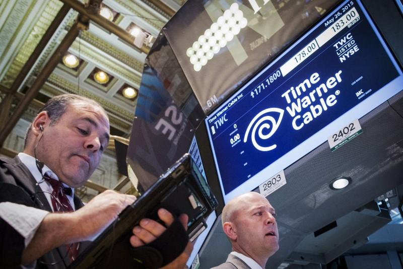 File photo of traders working at the post where Time Warner Cable is traded on the floor of the New York Stock Exchange