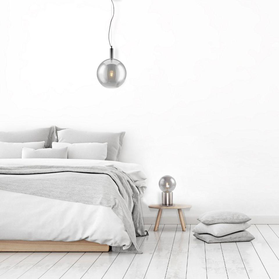 """<p>Why not use grey lighting as your starting point? Sophisticated grey glass globes add subtle colour in a bedroom and are a classic design. Match the ceiling pendant to a table lamp, then your bedlinen can follow suit.</p><p> Pictured: The Montpelier Ceiling pendant, £ 80 and Bishopston table lamp, £30, <a href=""""https://www.mabelhomeandlighting.com/"""" rel=""""nofollow noopener"""" target=""""_blank"""" data-ylk=""""slk:Mabel Home and Lighting"""" class=""""link rapid-noclick-resp"""">Mabel Home and Lighting</a></p>"""