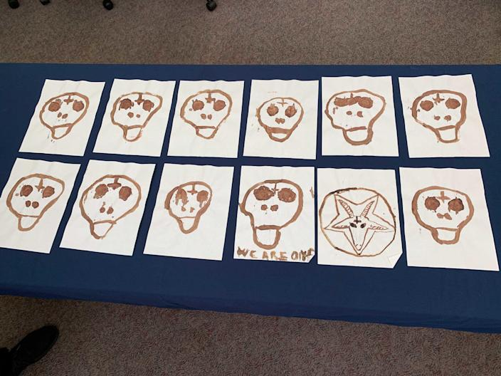 These skulls, drawn by serial killer Israel Keyes in his own blood, were found under his bed in his jail cell. The FBI is making them public for the first time. It is believed Keyes killed 11 people, as represented by the 11 skulls. / Credit: FBI