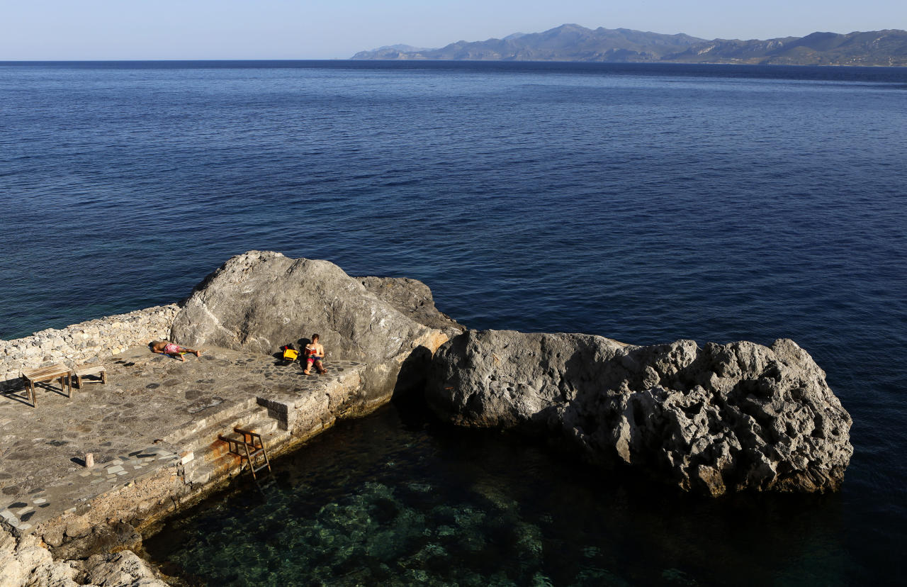 Foreign tourists are seen in a small bay in the town of Monemvasia Yannis Behrakis / Reuters