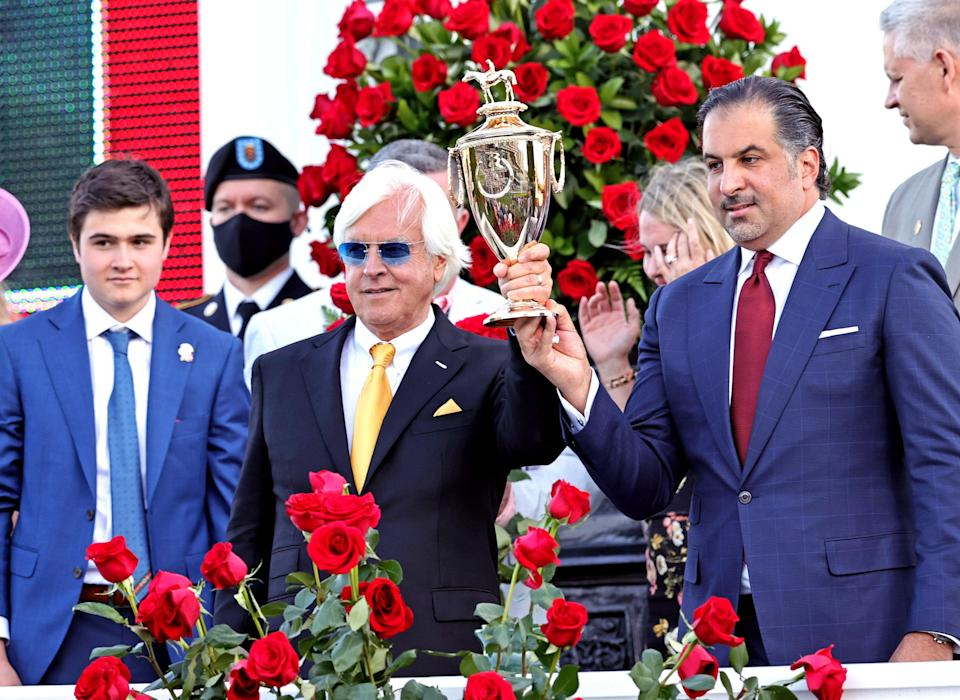 Medina Spirit owner Amr F. Zedan (right) and trainer Bob Baffert hold the trophy after winning the 147th running of the Kentucky Derby at Churchill Downs