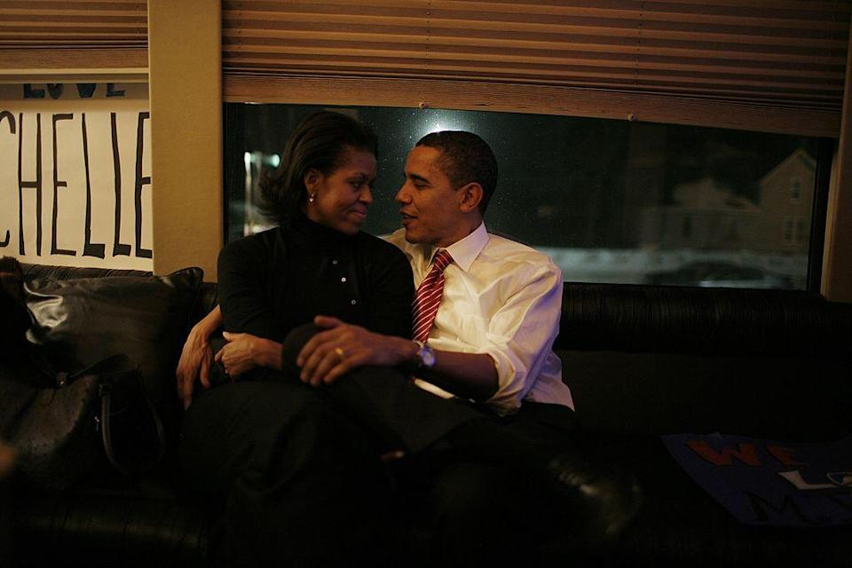 <p>Michelle and Barack take some time out on the last day of presidential candidates' campaigning before the Iowa caucus [Photo: Charles Ommanney/Getty] </p>
