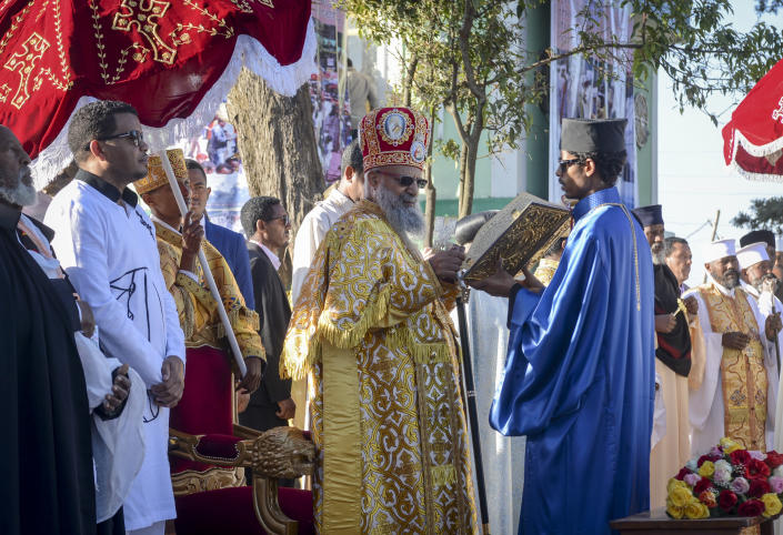 Patriarch of the Ethiopian Orthodox Church, Abune Mathias, reads the benediction during the annual festival of Timkat, or Epiphany, marking the baptism of Jesus Christ in the River Jordan, in the capital Addis Ababa, Ethiopia Monday, Jan. 20, 2020. During Timkat celebrations elsewhere in the country, in the city of Gondar, at least three people are dead after a wooden stand erected for the event collapsed on Monday, according to a hospital source. (AP Photo)