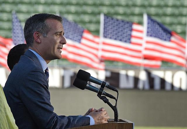 Los Angeles Mayor Eric Garcetti speaks at the podium to announce a deal with the International Olympic Committee to host the 2028 Summer Olympics during a news conference at StubHub Center July 3, 2017 in Carson, California (AFP Photo/KEVORK DJANSEZIAN)
