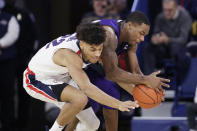 Gonzaga forward Jeremy Jones, left, and North Alabama guard Kendall Stafford go after the ball during the first half of an NCAA college basketball game in Spokane, Wash., Friday, Dec. 28, 2018. (AP Photo/Young Kwak)