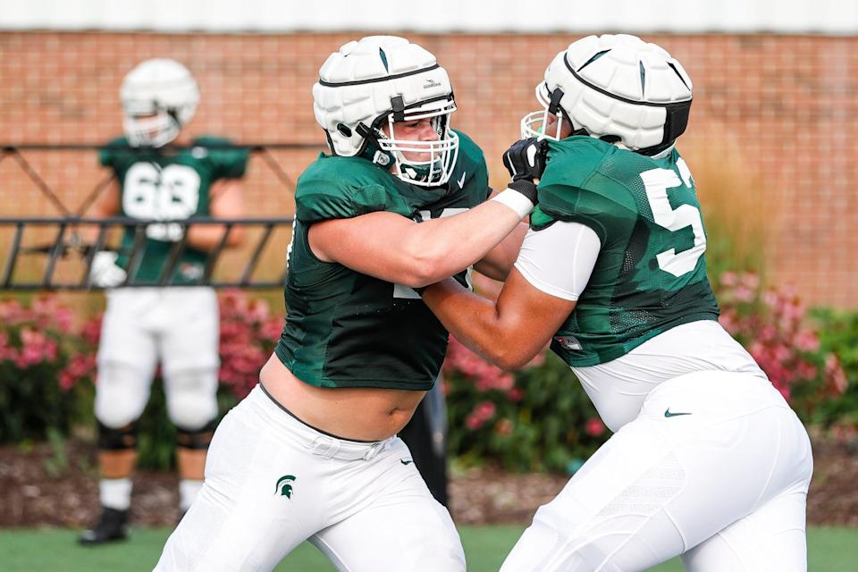 Michigan State offensive tackle Jarrett Horst (left) practices with offensive tackle Brandon Baldwin on Wednesday, Aug. 11, 2021 at the team's facility in East Lansing.