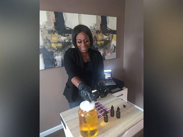 PHOTO: Londie Nichole mixes and bottles the oil. She is working on mass manufacturing for the future. She named the oil after her daughter, McKenzie, who was born prematurely. (Courtesy Londie Nichole)