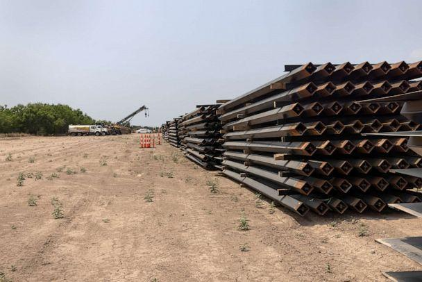 PHOTO: Unused pieces of steel bollard-style wall lay near a portion of unfinished border wall at the U.S.-Mexico border, April 14, 2021, La Joya, Texas. (John Moore/Getty Images)