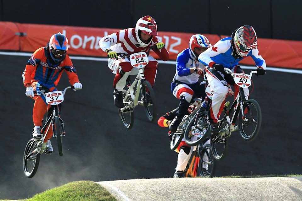 LONDON, ENGLAND - AUGUST 09: Tory Nyhaug (R) of Canada leads the field during the Men's BMX Cycling Quarter Finals on Day 13 of the London 2012 Olympic Games at BMX Track on August 9, 2012 in London, England. (Photo by Phil Walter/Getty Images)