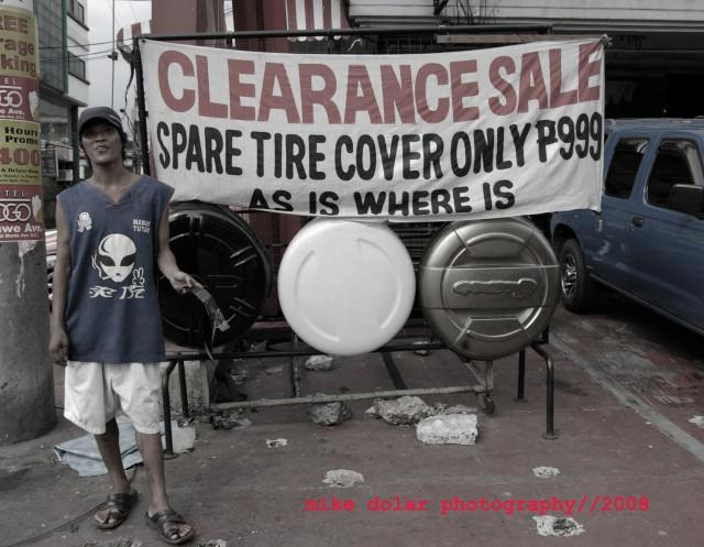 Man in Banawe selling knock-off tire covers