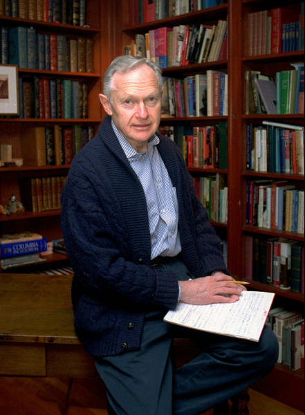 """FILE - In this May 28, 1996, file photo, Dr. Sherwin Nuland sits on the desk in his home study in Hamden, Conn. Nuland, the author of 1994 National Book Award winner """"How We Die,"""" has died at age 83. Nuland died of prostate cancer on Monday, March 3, 2014, at his home in Hamden, said his daughter Amelia Nuland, who recalled how he told her he wasn't ready for death because he loved life. (AP Photo/Bob Child, File)"""