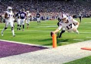 <p>Josh Allen #17 of the Buffalo Bills dives with the ball for a touchdown in the first quarter of the game against the Minnesota Vikings at U.S. Bank Stadium on September 23, 2018 in Minneapolis, Minnesota. (Photo by Hannah Foslien/Getty Images) </p>