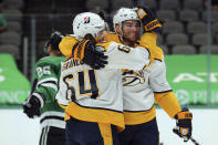 Nashville Predators center Mikael Granlund (64) celebrates the goal by Nashville Predators center Calle Jarnkrok (19) in the first period against the Dallas Stars during an NHL hockey game on Sunday, March 7, 2021, in Dallas. (AP Photo/Richard W. Rodriguez)