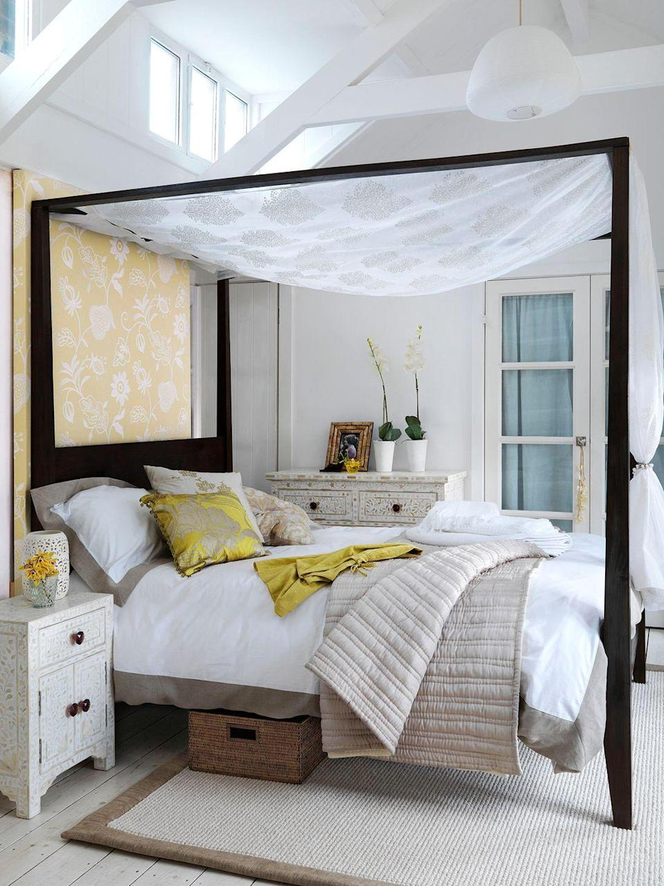 <p>For an instant romantic touch, drape sheer fabric across the upper portion of a canopy bed.</p>